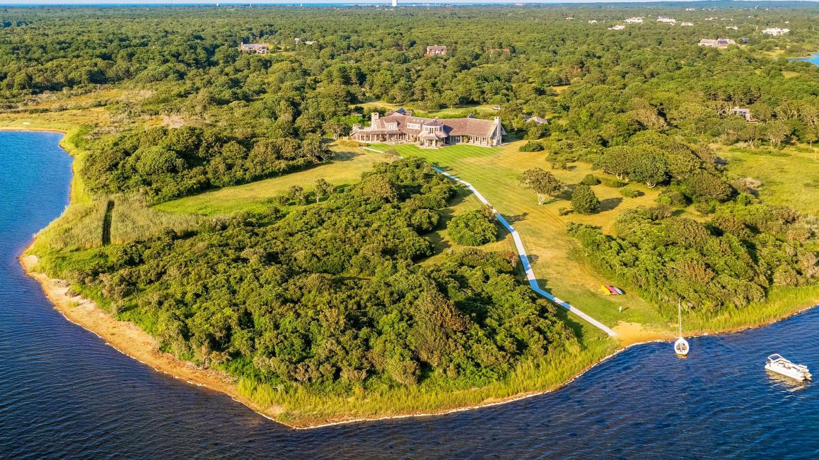 barack and michelle obama are reportedly planning to buy a huge estate in martha's vineyard, massachusetts.  the property is on the market for $14.85 million and features seven-bedrooms and nine bathrooms inside the 6,982 square foot main residence.  the home was originally put up for sale by from â??boston celticsâ?? owner wyc grousbeck in 2015 for $22.5 million. in 2017, it was reduced to $16.25 million before a further cut to the current asking price.   the former president and first lady rented out the home for the summer and reportedly loved it so much that they made an offer to buy it.  real estate insiders claim they havenâ??t paid the full asking price.  inside the main home, thereâ??s a chef's kitchen, and formal dining room surrounded by a wall of windows. the huge master bedroom suite opens up to a sundeck. outside, thereâ??s a pool and 29 acres including a private beach.   the obamas won't be the first presidential family to buy up on the massachusetts island.  jackie kennedy-onassis kept a home there until her death in 1994, and the summer resort was popular with the whole kennedy dynasty.   estate agent tom wallace said:â? it's a remarkable home on an absolutely gorgeous setting. it certainly has the capacity to expand to more of a compound. one could build two additional full-size properties.  their new home is on the edge of edgartown great pond, with views of the atlantic ocean.